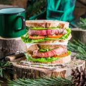 Coffee and homemade sandwich for woodcutter — Stock Photo