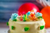Blown out candles on birthday cake — Stock Photo