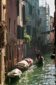 Gondolier Floating in a canal in Venice — Stock Photo