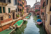 Boats and motorboats on a canal in Venice — Stock Photo