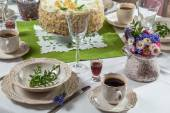 Festively decorated table with served coffee and cake — Stock Photo