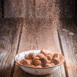 Falling cocoa powder on chocolate balls — Stock Photo #64635391