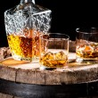 Two glasses of aged whiskey or brandy on the rocks — Stock Photo #65126541