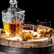 Two glassed of aged brandy or whiskey on the rocks — Stock Photo #65126547