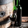 Wooden oak barrel and a glass of Wine — Stock Photo #65126587
