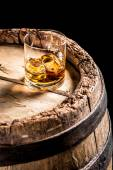 Glass of aged Scotch in the distillery basement — Stock Photo