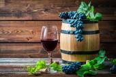 Glass of red wine in a wooden cellar — Stock Photo