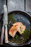 Hot grilled meat with fresh herbs ready to eat — Stock Photo