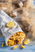 Tasty fish and chips with lemon — Stock Photo