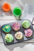 Preparation for sweet cupcakes with cream — Stock Photo