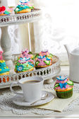 Tasty cupcakes with sweet decoration and coffee — Stock Photo