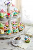 Delicious muffins with cream and sweet decoration — Stock Photo