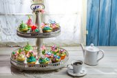 Delicious cupcakes with sweet decoration — Stock Photo