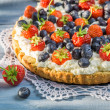 Tart with strawberries and blueberries — Stock Photo #74151935