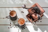 Freshly milled coffee with beans — Stock Photo