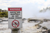 Warning sign for water and mudpools — Stock Photo