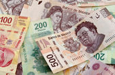 Mexican Peso bank notes background — Stock Photo
