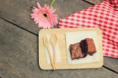 Brownies with wooden spoon and fork — Stock Photo