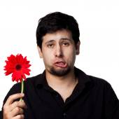 Young man with flower — Stock Photo