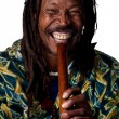 Rastafarian playing the flute — Stock Photo #65282919