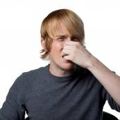 Man covers his nose — Stockfoto