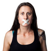 Silenced woman with tape — Stock fotografie