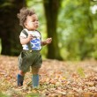 Girl in the woods playing — Stock Photo #66285309