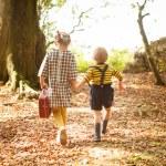 Children leaving the woods — Stock Photo #66288171