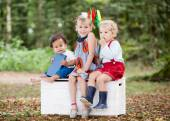 Children outside with books — Stock Photo