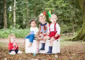 Children sitting outside — Stock Photo