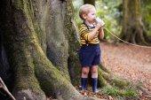 Boy talking on a tin can communicator. — Stock Photo