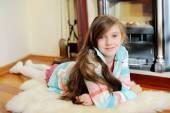 Kid  girl near fireplace — Stock Photo
