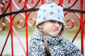 Little angry girl portrait outside — Stock Photo