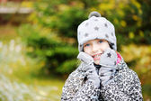 Kid girl has fun in garden with first snow — Photo
