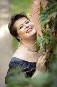 Chubby woman smiling — Foto Stock