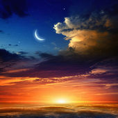 Red sunset and moon — Stock Photo