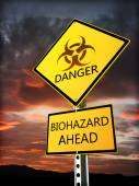 Warning bio hazard sign posted near the danger zone. — Stock Photo