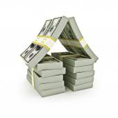 Stack of bills in the shape of a house on a white background. — Stock Photo