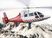 Rescue helicopter in flight over snow capped mountains with motion blur blades. — Stock Photo