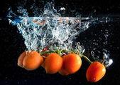 Tomatoes splash — Stock Photo