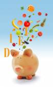 Piggy bank with fruits and vegetables — Стоковое фото