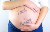 """Pregnant woman belly with """"Family Planning"""" text — Stock Photo"""