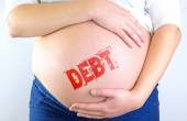 Pregnant woman belly with Debt stamp — Stock Photo