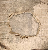 Abstract grunge wall background with paper hole in the middle — Stock Photo
