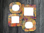 Group of blank colorful painted cardboard frames on grunge background — Stock Photo