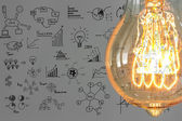 Light bulb with drawing graph — Stock Photo