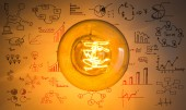 Top view of vintage glowing light bulb with drawing graph — Stock Photo