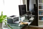 Modern home office with computer and laptop — Stock Photo