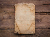 Old book on wood background — Stock Photo
