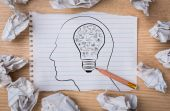 White note book paper with  pencil draw  light bulb inside a hea — Stock Photo